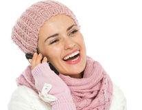 Happy girl in knit winter clothing speaking mobile Stock Photo