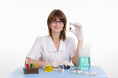 Happy girl in a laboratory Stock Images