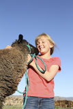 Happy Girl and Lamb. A happy young girl interacts with her 4-H project lamb Royalty Free Stock Image