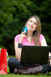 Happy girl with a laptop Royalty Free Stock Photography