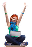 Happy girl with laptop. Happy girl sitting with laptop over white Royalty Free Stock Photos