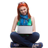 Happy girl with laptop. Happy girl sitting with laptop over white Stock Photos