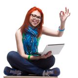 Happy girl with laptop. Happy girl sitting with laptop over white Stock Images