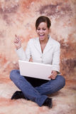 Happy girl with laptop. Happy girl with white laptop computer Stock Photography