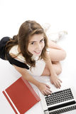 Happy girl with laptop. And backpack Royalty Free Stock Photo