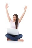 Happy girl with laptop hands up. Happy girl smiling hands up, having laptop, sitting on floor Stock Photo