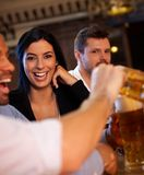 Happy girl laughing in pub Stock Images