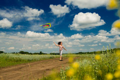 Happy girl launches a kite Stock Photo