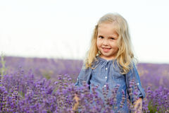 Happy girl in lavender field Royalty Free Stock Photos