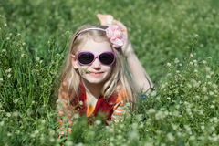 Happy girl lay in grass Royalty Free Stock Photos