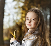 Happy girl in leaves autumn Royalty Free Stock Images