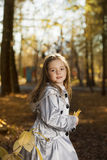 Happy girl in leaves autumn Royalty Free Stock Image