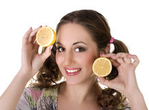 Happy girl with lemon in her hands Royalty Free Stock Images