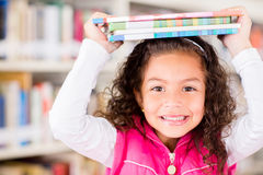 Happy girl at the library Stock Photography