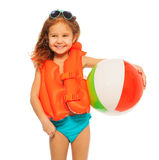 Happy girl in lifejacket with colored rubber ball stock photos