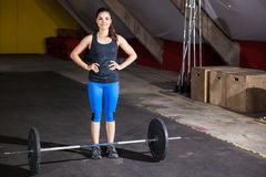 Happy girl about lift some weights Royalty Free Stock Image
