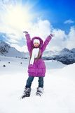 Happy girl with lifted hands on winter day Stock Image