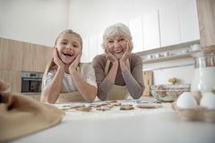 Happy girl likes to cook with her granny Royalty Free Stock Image