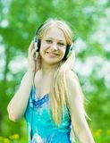 Happy girl listening music Stock Images