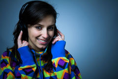 Happy girl listening a music Stock Images