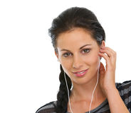 Happy girl listening music in headphones Stock Images