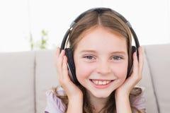 Happy girl listening music through headphones Stock Photography
