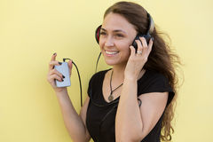 Happy girl listening to music Stock Photos