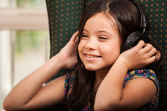 Happy girl listening to music Stock Image