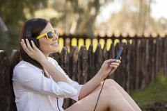 Happy girl listening to music Stock Photo