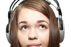 Happy girl listening to the music. Happy girl with headphones listening to music Royalty Free Stock Photo