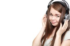 Happy girl listening to the music. Happy girl with headphones listening to music Stock Photography