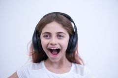 Happy girl listening to music with headphones Stock Photo