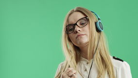 Happy girl listening to music on headphones stock footage