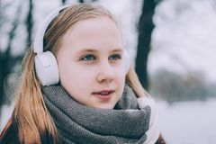 Happy Girl Listening to Music with Headphones stock images