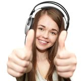 Happy girl listening to the music. Ok Royalty Free Stock Images