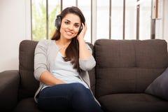Happy girl listening to music Stock Image