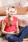 Happy girl listening to the music from smartphone Stock Photography