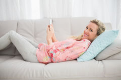 Happy girl listening to music and using a mobile phone Stock Photography