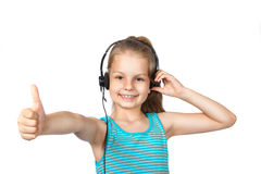 Happy girl listening to music on a white background Royalty Free Stock Photos