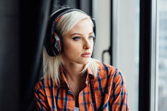 Happy girl listening to the music at window Royalty Free Stock Images