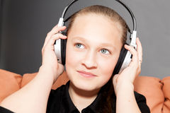 Happy girl listening to music Royalty Free Stock Image