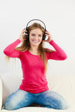Happy girl listening to music. Stock Images