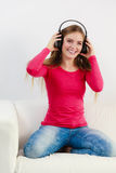 Happy girl listening to music. Stock Photo
