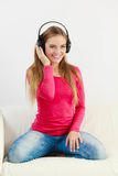Happy girl listening to music. Royalty Free Stock Photo