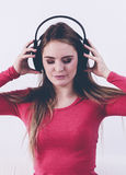 Happy girl listening to music. Stock Image