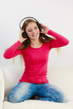 Happy girl listening to music. Stock Photos