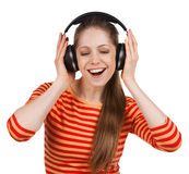Happy girl listens to music on headphones Royalty Free Stock Images