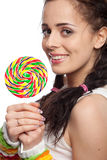 Happy girl with lollipop. Stock Photos