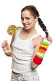 Happy girl with lollipop. Royalty Free Stock Image
