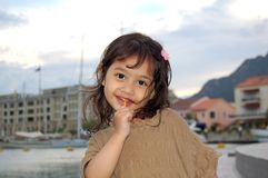 Happy Girl and Lollipop. A cute girl having lollipop at the seaside in  family vacation Stock Photo